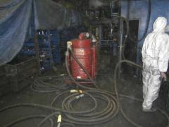 Nettoyage à l'aspirateur des salles de production
